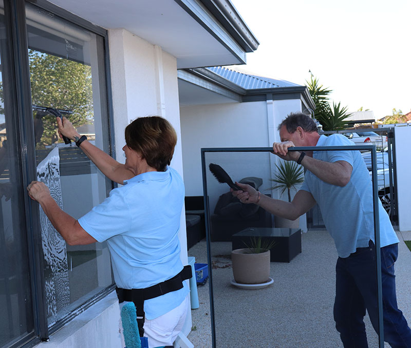 man and woman window cleaning